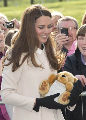 Catherine, Duchess of Cambridge receives a teddy bear as she visits the offices of Child Bereavement UK on March 19, 2013 in Saunderton, Buckinghamshire
