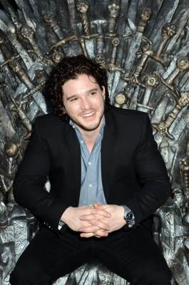 Kit Harington sits on the Iron Throne as he attends the Academy of Television Arts & Sciences an evening with HBO's 'Game Of Thrones' at TCL Chinese Theatre on March 19, 2013