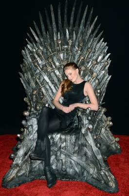 Sophie Turner (Sansa Stark) sits on the Iron Throne at the Academy of Television Arts & Sciences an evening with HBO's 'Game Of Thrones' event at TCL Chinese Theatre on March 19, 2013