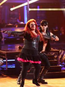 Wynonna Judd and Tony Dovolani rock out during prom night, Week 3, 'Dancing with the Stars,' Season 16, April 1, 2013