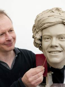 Madame Tussauds, sculptor Jim Kemp works on the clay head of Harry Styles of One Direction. Madame Tussauds announced on March 11, 2013 that the world famous wax attraction will immortalize the band by creating five individual wax figures of each member