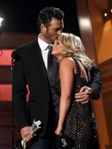 Blake Shelton (L) and Miranda Lambert accept the Song of the Year award onstage during the 48th Annual Academy of Country Music Awards at the MGM Grand Garden Arena on April 7, 2013