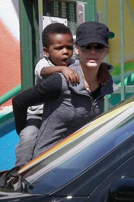 Sandra Bullock gives her son Louis a piggyback ride as she picks him up from school in Los Angeles on March 26, 2013