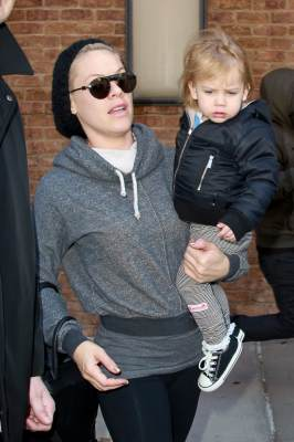 Pink carries her daughter Willow out of the Greenwich Hotel as they set out in New York City on March 27, 2013
