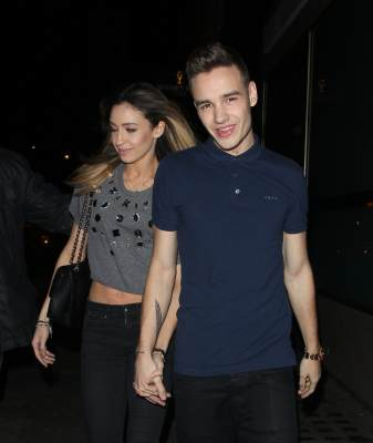 Danielle Peazer and One Direction's Liam Payne at Whiskey Mist night club on April 2, 2013 in London