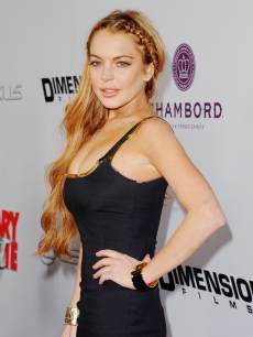 Lindsay Lohan arrives at the premiere of &#8216;Scary Movie V&#8217; at ArcLight Cinemas Cinerama Dome on April 11, 2013 in Hollywood, Calif.