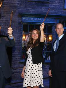 Prince Harry, Catherine, Duchess of Cambridge and Prince William, Duke of Cambridge raise their wands on the set of the Harry Potter Films during the Inauguration Of Warner Bros. Studios Leavesden on April 26, 2013 in London, England
