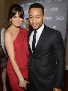 Chrissy Teigen and John Legend attend the PEOPLE/TIME Party On The Eve Of The White House Correspondents' Dinner in Washington, DC on April 26, 2013