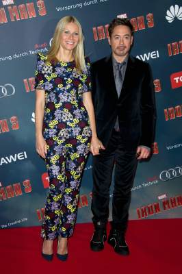 Gwyneth Paltrow and Robert Downey Jr. pose during the 'Iron Man 3' photocall at Le Grand Rex in Paris on April 14, 2013