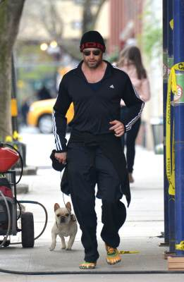 Hugh Jackman goes out for a morning jog — with his adorable pup in tow — in New York City on April 15, 2013