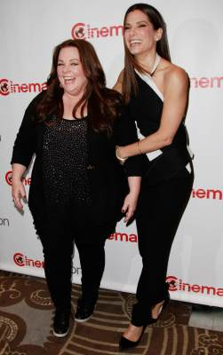 Melissa McCarthy and Sandra Bullock arrive at the 20th Century Fox Cinemacon Press Conference at Caesars Palace during CinemaCon 2013 on April 18, 2013 in Las Vegas