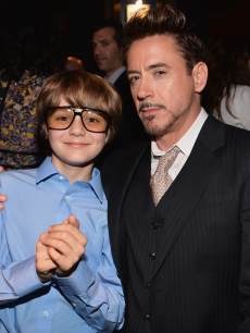 Ty Simpkins and Robert Downey Jr. attend Marvel&#8217;s &#8216;Iron Man 3&#8217; premiere after party at Hard Rock Cafe on April 24, 2013 in Hollywood, Calif.
