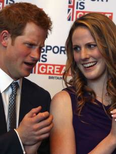 Prince Harry chats with Missy Franklin at a reception at the Sanctuary Golf Course on May 10, 2013 in Sedalia, Colorado