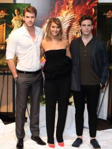 Liam Hemsworth, Jennifer Lawrence and Sam Claflin are seen at the photocall for &#8216;The Hunger Games: Catching Fire&#8217; at The 66th Annual Cannes Film Festival at Majestic Hotel on May 18, 2013 in Cannes, France