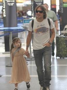 Cute! Keith Urban and daughter Sunday Rose spotted at LAX airport in Los Angeles on May 17, 2013