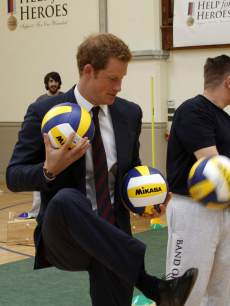 Prince Harry shows off his fancy footwork during his visit to Tedworth House to officially open the charity's Tedworth House recovery centre on May 20, 2013 in Tidworth, England