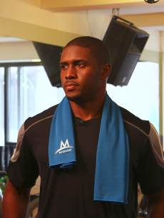 Reggie Bush shows off MISSION Athletecare's new line of EnduraCool Instant Cooling Towels