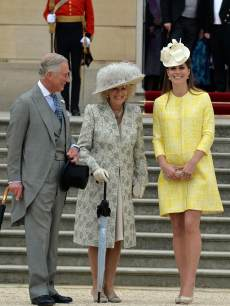 Prince Charles, the Prince of Wales, Camilla, the Duchess of Cornwall and Catherine, the Duchess of Cambridge attend a Garden Party in the grounds of Buckingham Palace, central London on May 22, 2013