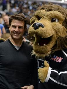 Tom Cruise poses for a picture with Los Angeles Kings mascot in Game Five of the Western Conference Semifinals during the 2013 Stanley Cup Playoffs at Staples Center on May 23, 2013 in Los Angeles