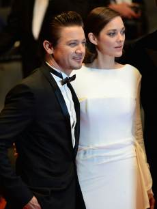 Jeremy Rennerand Marion Cotillard leave 'The Immigrant' Premiere during the 66th Annual Cannes Film Festival at Grand Theatre Lumiere on May 24, 2013 in Cannes, France