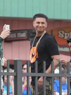 Vinny Guadagnino, Paul DelVecchio and Nicole Polizzi of 'The Jersey Shore' watch when the music group fun. performs on NBC's 'Today'on the beach at the Seaside Heights Boardwalk on May 24, 2013