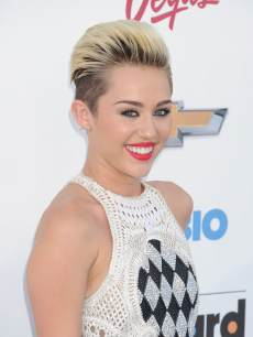 Miley Cyrus arrives at the 2013 Billboard Music Awards at the MGM Grand Garden Arena on May 19, 2013 in Las Vegas