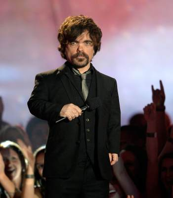 Peter Dinklage speaks onstage during the 2013 MTV Movie Awards at Sony Pictures Studios on April 14, 2013 in Culver City