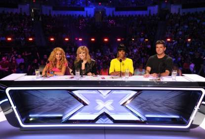 The judges' panel for 'The X Factor' Season 3 — Paulina Rubio, Demi Lovato, Kelly Rowland and Simon Cowell