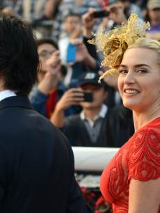 Ned Rocknroll and Kate Winslet attend the Longines Hong Kong Cup Race at the Hong Kong International Races at the Shatin racecourse in Hong Kong, December 9, 2012