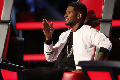 Usher critiques a contestant during the Top 6 performance night on 'The Voice'