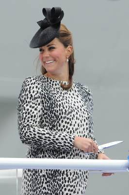 The Duchess of Cambridge smiles as she holds the scissors to cut the rope that will release a bottle to smash on the hull during a ceremony to officially name Princess Cruises's new ship 'Royal Princess' in Southampton, southern England on June 13, 2013