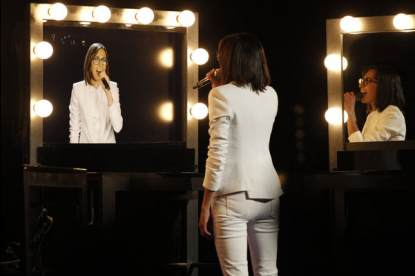 Michelle Chamuel performs into a video mirror on 'The Voice,' June 17, 2013