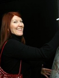 Kate Flannery smiles as she leaves her John Hancock