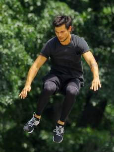 Taylor Lautner shows off his best parkour moves while filming his new movie 'Tracers' in New York City on June 18, 2013