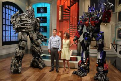 More than meets the eye! Billy and Kit pose with Megatron and Optimus Prime from Universal Studios' Transformers ride!