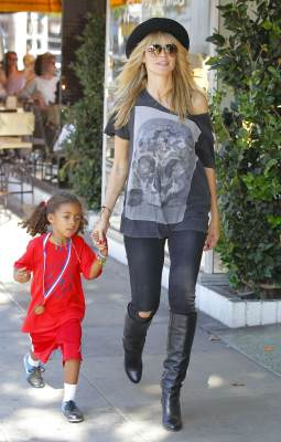 Heidi Klum and daughter Lou Samuel are seen on November 10, 2013 in Los Angeles