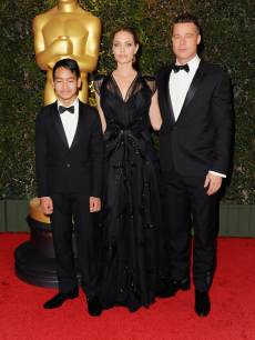 Angelina Jolie, Brad Pitt and son Maddox Jolie-Pitt arrive at The Board Of Governors Of The Academy Of Motion Picture Arts And Sciences' Governor Awards at Dolby Theatre on November 16, 2013 in Hollywood