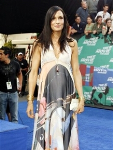 Famke Janssen poses for the press
