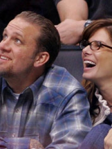 With husband Jesse James at an LA Kings game, Nov. 2005