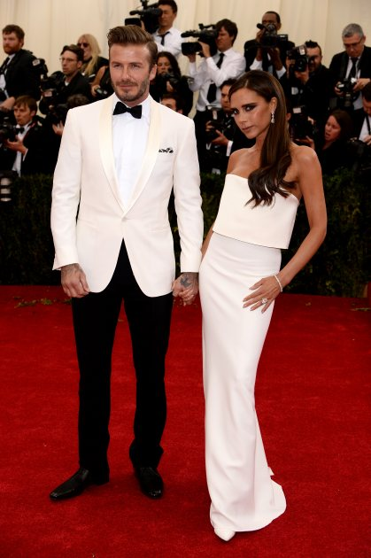 David Beckham & Victoria Beckham arrive to the 'Charles James: Beyond Fashion' Costume Institute Gala at the Metropolitan Museum of Art on May 5, 2014 in New York City (Getty)