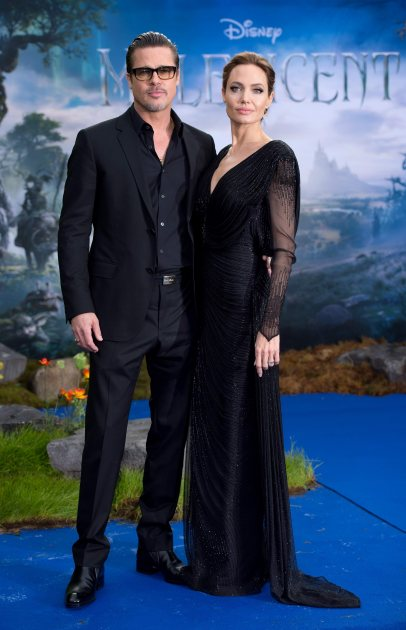 Brad Pitt and Angelina Jolie attend a private reception as costumes and props from Disney's 'Maleficent' are exhibited in support of Great Ormond Street Hospital held at Kensington Palace on May 8, 2014 in London (WireImage)