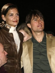 Katie Holmes and Tom Cruise look awed by the music