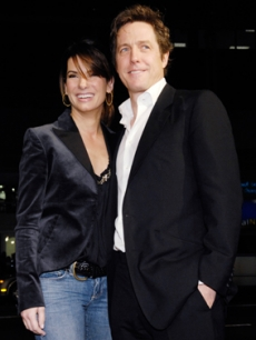 Hugh poses on the red carpet with Sandra Bullock, Feb. 2007