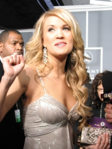 Carrie Underwood gets ready to show the victory sign