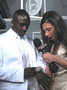 Akon shows Stacy his fancy watch made of diamonds