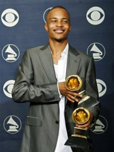 T.I. poses with his awards