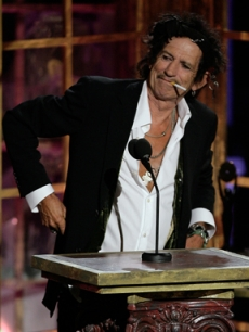 Keith Richards lights a cig while presenting at the Hall of Fame