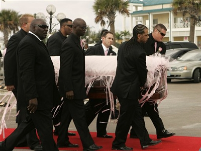 Anna Nicole Smith's body is carried into the church