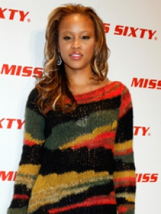 Eve poses on the Miss Sixty red carpet