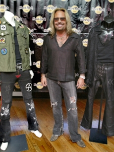 Motley Crue singer Vince Neil with two costumes from the band's last tour